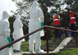 meeting counterparts in protective suits